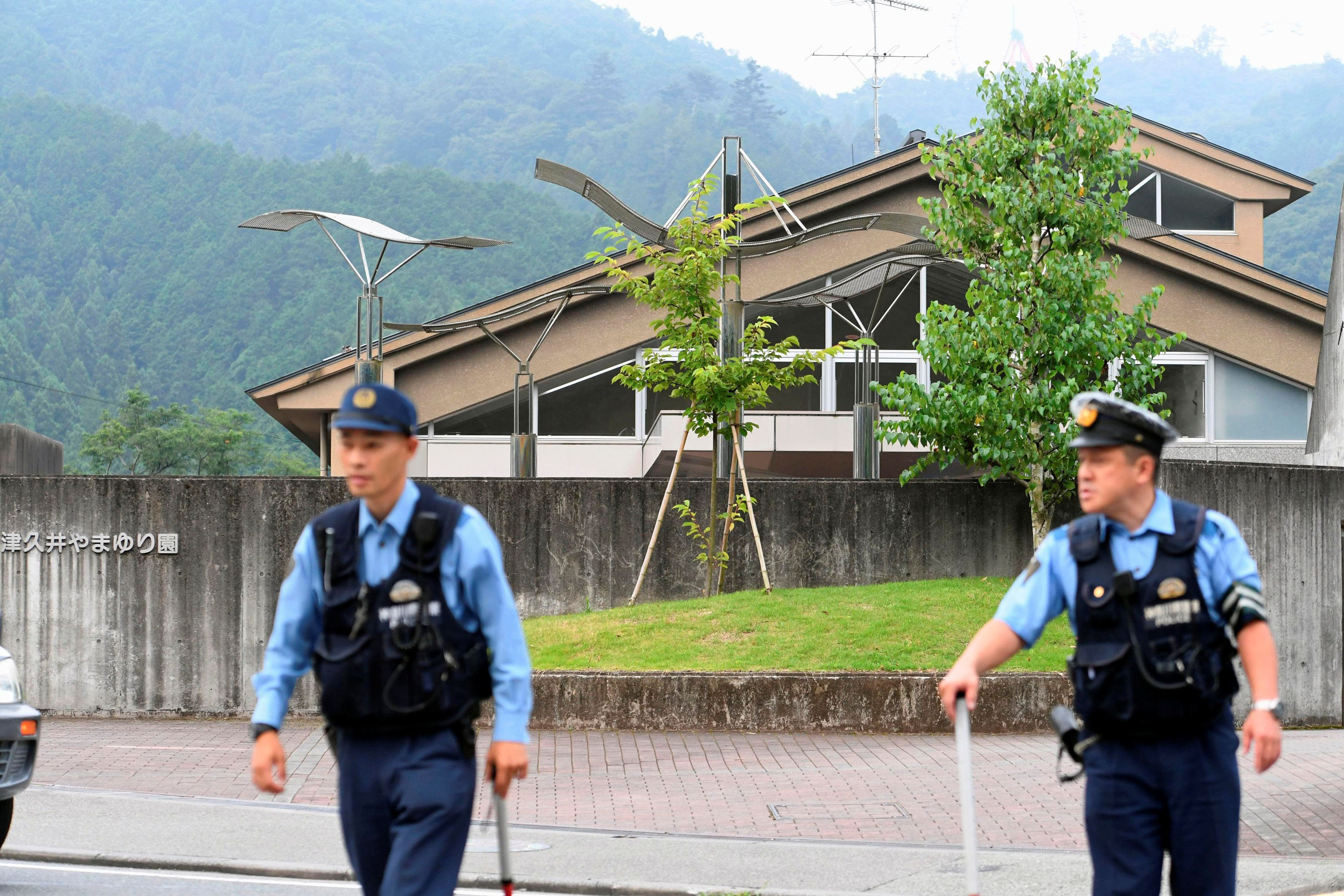 Police officers are seen in front of a facility for the disabled where a knife-wielding man attacked...