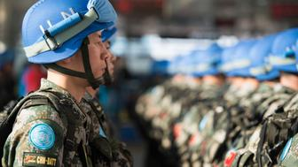 JINAN, CHINA - APRIL 07:  (CHINA OUT) The last peacekeeping squad gets ready for South Sudan during the 25th anniversary of China's peacekeeping for the United Nations on April 7, 2015 in Jinan, Shandong province of China. China has participated the peacekeeping missions of United Nations for 25 years.  (Photo by VCG/VCG via Getty Images)