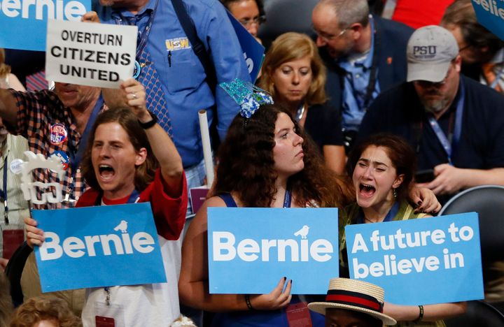 Supporters of Sen. Bernie Sanders (I-Vt.) listen to him speak during the Democratic National Convention in Philadelphia on Mo