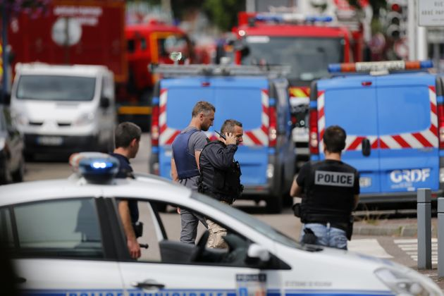French police officers and firemen arrive at the scene of a hostage-taking at a church in Saint-Etienne-du-Rouvray,...