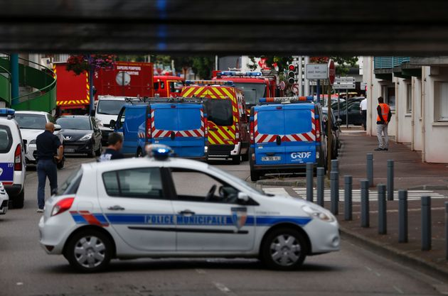 Two knifemen were killed by police after they took several people hostage in a French