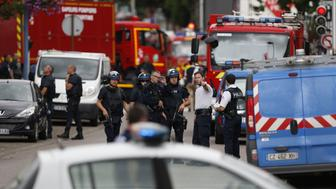 French police officers and fire engine arrive at the scene of a hostage-taking at a church in Saint-Etienne-du-Rouvray, northern France, on July 26, 2016 that left the priest dead. A priest was killed on July 26 when men armed with knives seized hostages at a church near the northern French city of Rouen, a police source said. Police said they killed two hostage-takers in the attack in the Normandy town of Saint-Etienne-du-Rouvray, 125 kilometres (77 miles) north of Paris.   / AFP / CHARLY TRIBALLEAU        (Photo credit should read CHARLY TRIBALLEAU/AFP/Getty Images)