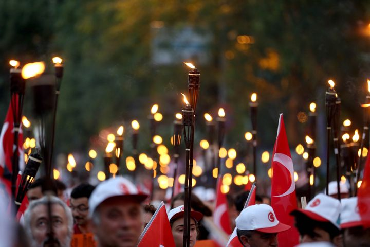 People march against Gulen in Istanbul on Monday. The scale of the arrests and suspensions following the coup attempt ha