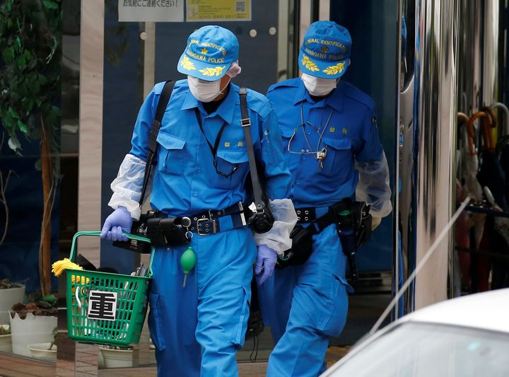 Police officers investigate at a facility for the disabled, where a deadly attack by a knife-wielding man took place, in Sagamihara, Kanagawa prefecture.
