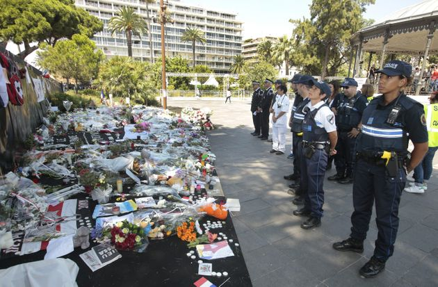 Police gather to observe a minute's silence in tribute to the victims of the deadly Nice attack at La...