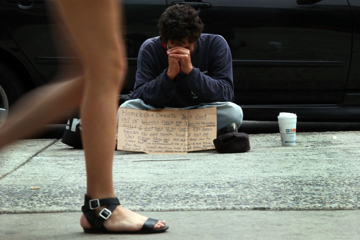 PHILADELPHIA, PA - SEPTEMBER 22: A homeless man panhandles on a street in downtown Philadelphia where Pope Francis is schedul