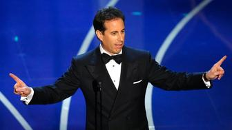 Comedian Jerry Seinfeld presents the Oscar for documentary feature at the 79th Annual Academy Awards in Hollywood, California, February 25, 2007.   REUTERS/Gary Hershorn   (UNITED STATES)    IMAGES FROM THE PRESS ROOM AND SHOW FROM THE 79TH ANNUAL ACADEMY AWARDS ARE EMBARGOED FROM INTERNET, CELL PHONE AND OTHER ONLINE DISTRIBUTION UNTIL THE CONCLUSION OF THE OSCAR TELECAST (APPROX  0400 GMT) AS MANDATED BY THE ACADEMY OF MOTION PICTURE ARTS AND SCIENCES.    TEMPLATE OUT
