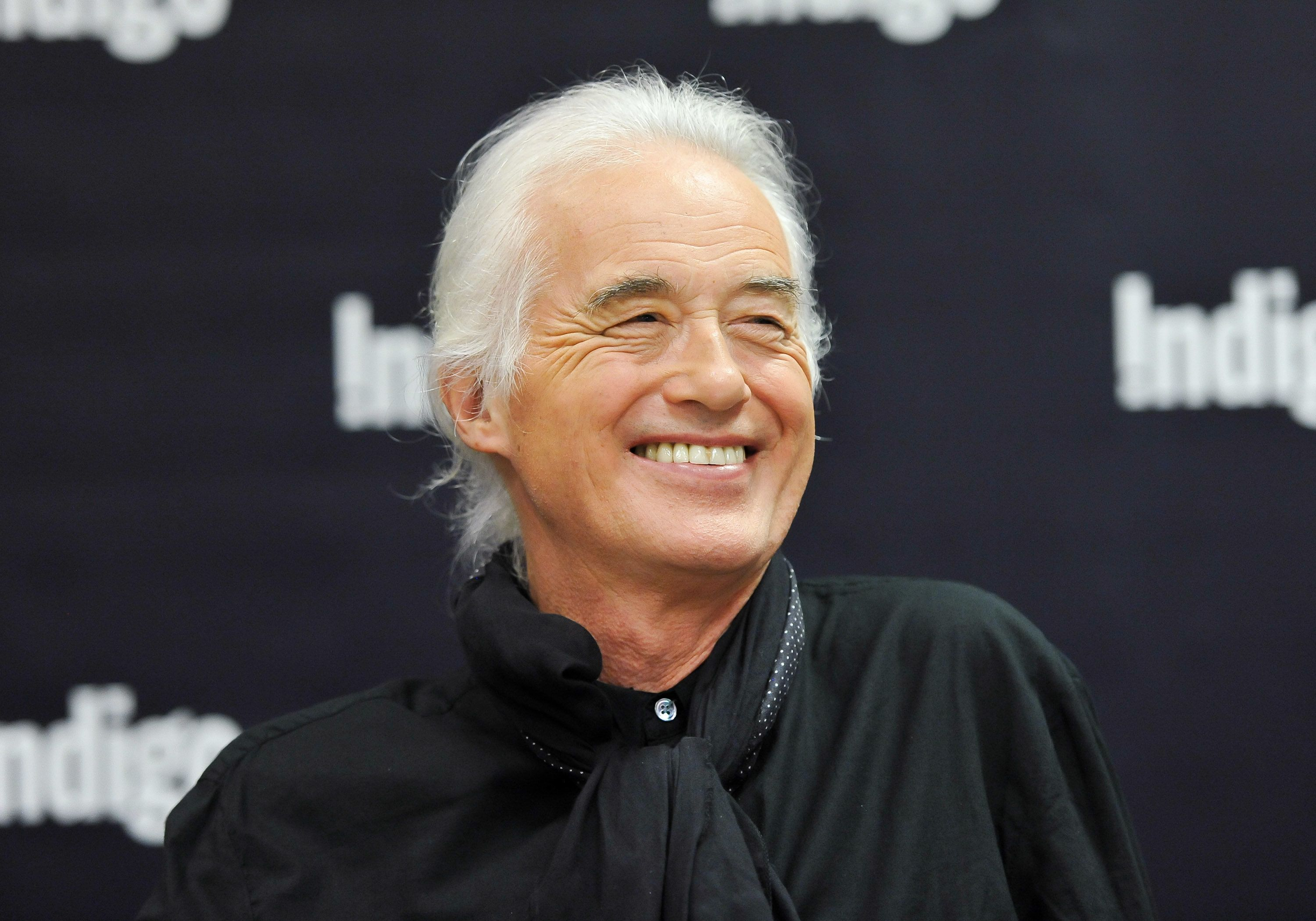 TORONTO, ON - JULY 21:  Jimmy Page signs copies of his new book 'Jimmy Page' at the Indigo Manulife Centre on July 21, 2015 in Toronto, Canada.  (Photo by George Pimentel/WireImage)