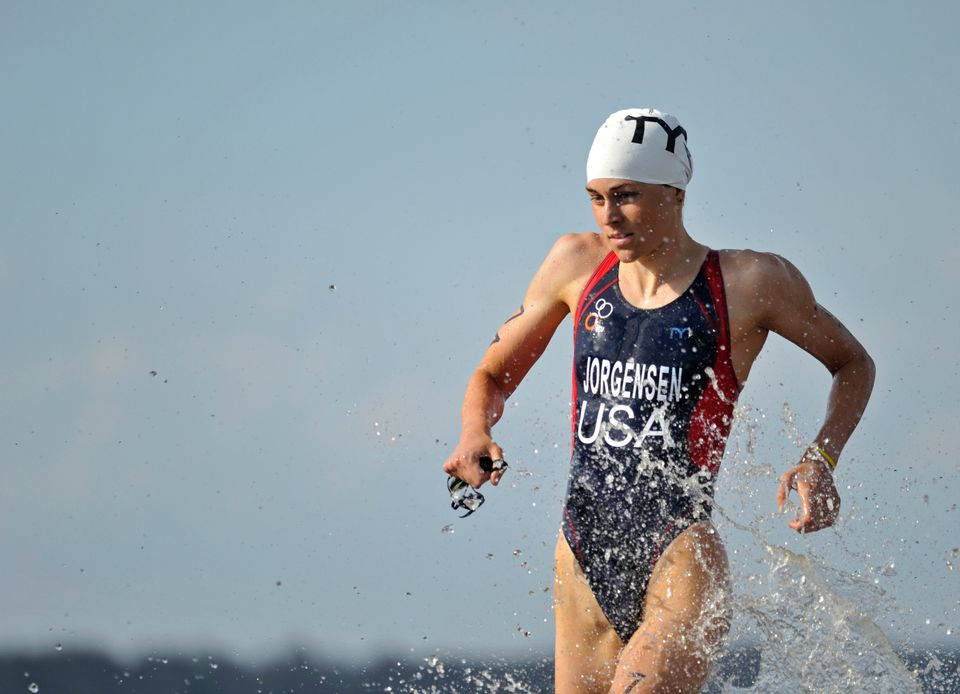 U.S. triathlete Gwen Jorgensen exits the water during the second annual Draft Legal Challenge in Clermont, Florida March 3, 2