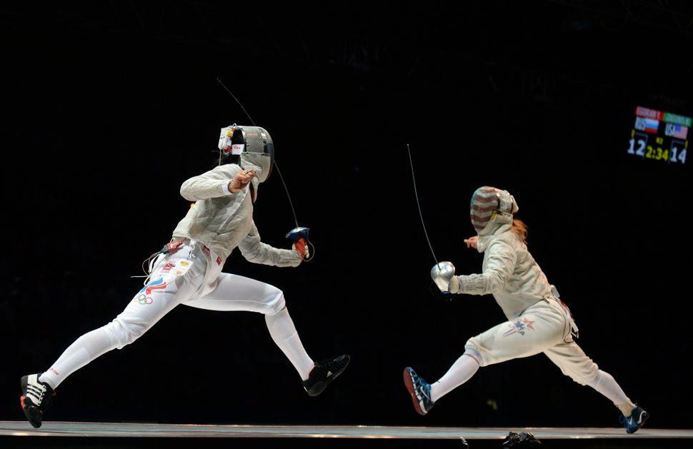 Mariel Zagunis of the United States (R) competes against Yana Egorian of Russia (L) during the women's sabre semi-finals comp