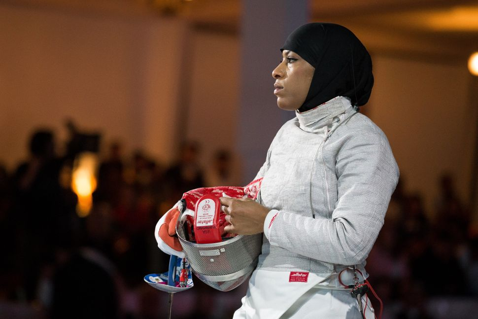 Ibtihaj Muhammad of the USA waits to fence during the Team Women's Sabre gold medal match against Mexico.