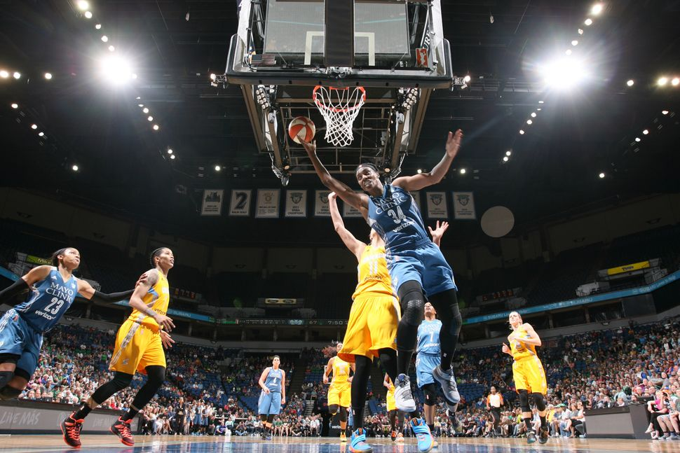 Sylvia Fowles (#34) of the Minnesota Lynx goes for a layup against the Chicago Sky on July 5, 2016 in Minneapolis, Minnesota.