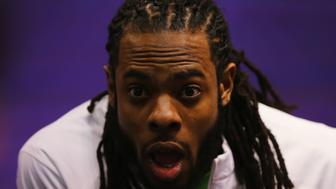 PHOENIX, AZ - JANUARY 27:  Richard Sherman #25 of the Seattle Seahawks addresses the media at Super Bowl XLIX Media Day Fueled by Gatorade inside U.S. Airways Center on January 27, 2015 in Phoenix, Arizona.  (Photo by Elsa/Getty Images)