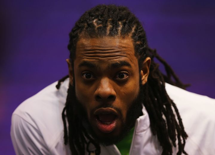 Richard Sherman of the Seattle Seahawks addresses the media at Super Bowl XLIX Media Day on January 27, 2015.