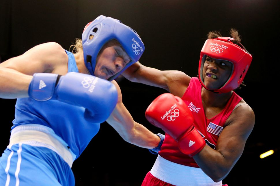 Claressa Shields (R) of the United States exchanges punches with Nadezda Torlopova (L) of Russia during the Women's Middle Bo