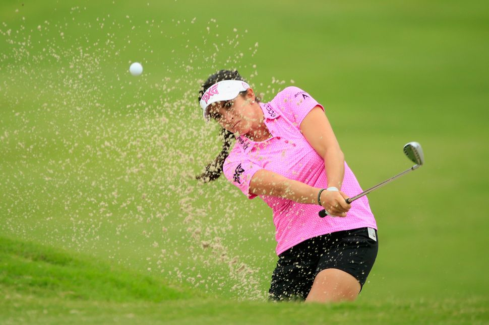 Gerina Piller plays a bunker shot on the tenth hole during the second round of the Volunteers of America Texas Shootout