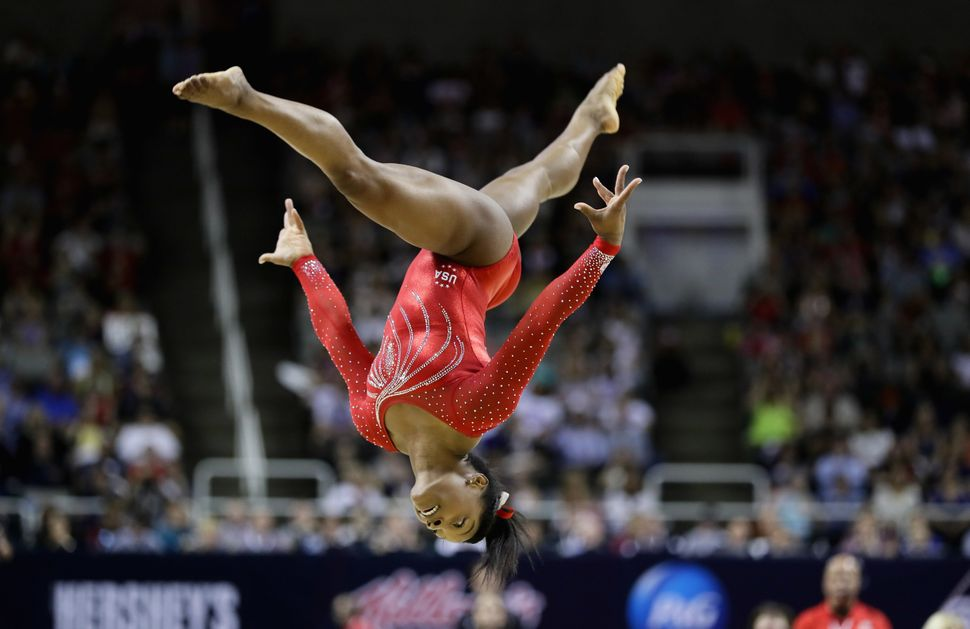 Simone Biles competes in the floor exercise during Day 2 of the 2016 U.S. Women's Gymnastics Olympic Trials at SAP Center on