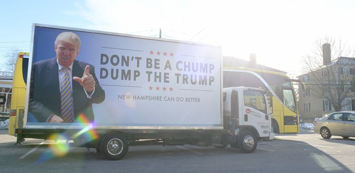 An anti-Trump billboard is seen outside of Exeter Town Hall where then-Republican presidential candidate Ted Cruz spoke on&nb