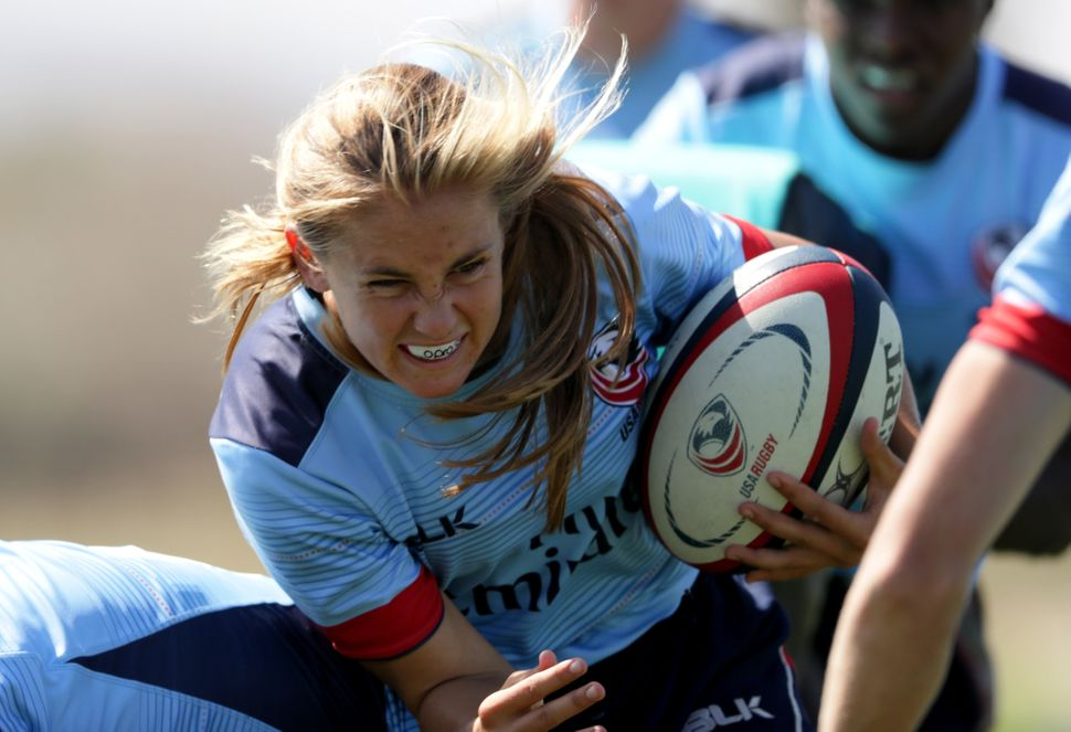 USA Rugby hopeful Richelle Stephens runs with the ball during a training session at the Olympic Training Center on July 14, 2