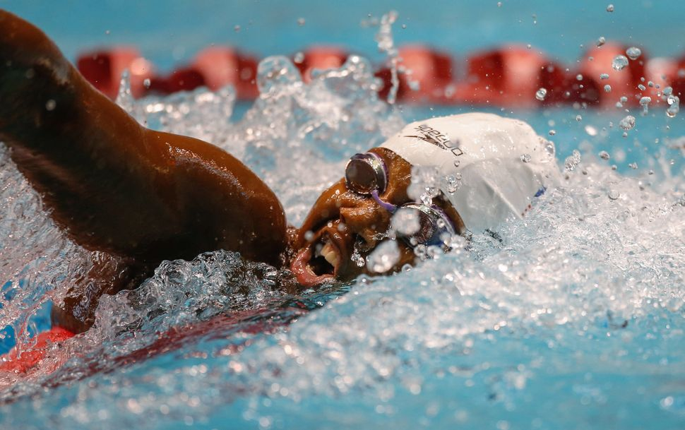 Simone Manuel swims in the preliminary 200 Meter Freestyle during the Winter National Championships on December 4, 2015 in Fe