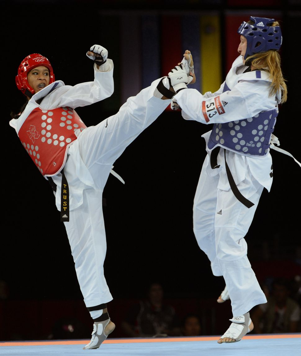 Slovenia's Franka Anic (blue) fights against US athlete Paige Mcpherson (red) during their women's taekwondo bronze medal bou