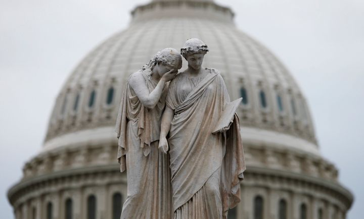 The statue of Grief and History in front of the U.S. Capitol Dome in Washington.