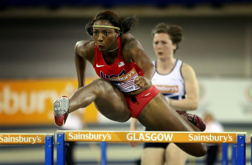 Nia Ali of the US competes in the Women's 60m Hurdles event at the British Athletics Glasgow International match on January 2