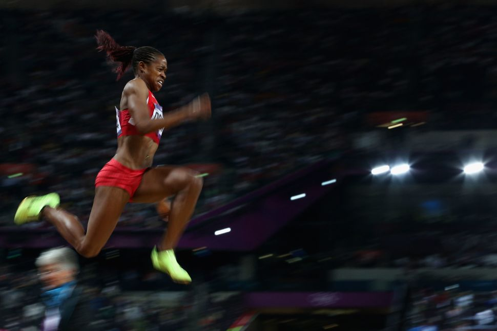 Janay Deloach of the United States competes in the Women's Long Jump Final on Day 12 of the London 2012 Olympic Games on Augu