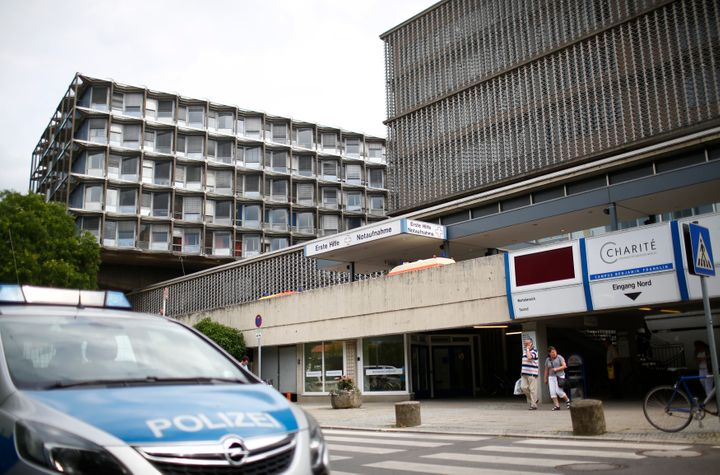A police car is parked in front of the university clinic in Steglitz, a southwestern district of Berlin.