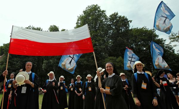Nuns hold flags near the main square during World Youth Day in Krakow, Poland, July 26, 2016.