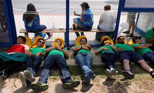 Pilgrims rest on a bus stop during World Youth Day in Krakow, Poland, July 26, 2016.