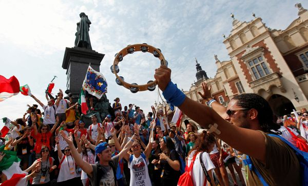 Pilgrims sing songs at the main square during World Youth Day in Krakow, Poland, July 26, 2016.