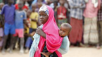 "A Somali refugee child carries her sibling at the Ifo camp in Dadaab near the Kenya-Somalia border, May 8, 2015. Kenya's government threatened to close the Dadaab refugee camp, which with about 350,000 Somali refugees is the world's biggest refugee camp, as a security risk. The United Nations refugee agency urged Kenya to reconsider an order to close the teeming Dadaab refugee camp, warning that sending Somali refugees back to their homeland would have ""extreme humanitarian and practical consequences"". REUTERS/Thomas Mukoya"