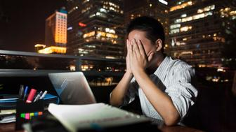 Chinese businessman working at desk at night
