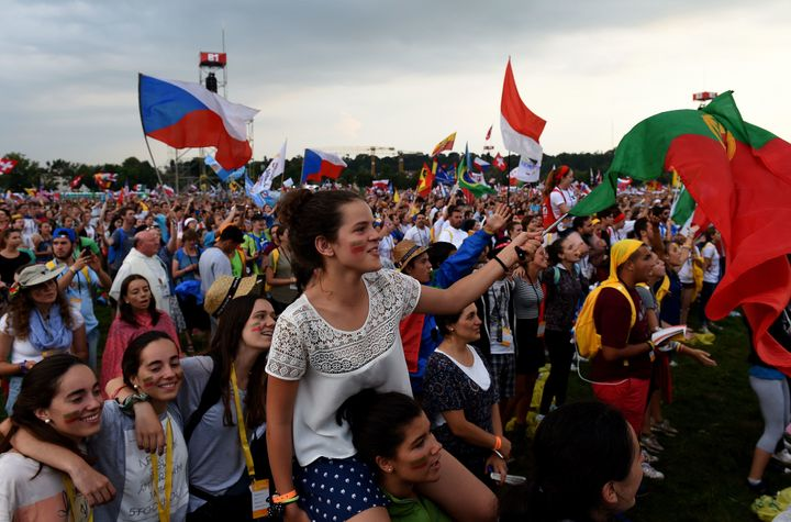 Pilgrims from all over the world celebrate after the Opening Mass on the first day of the World Youth Days, on the Blonia Mea