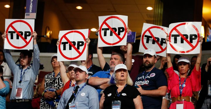 Delegates protest the controversial trade deal during the Democratic convention in Philadelphia.