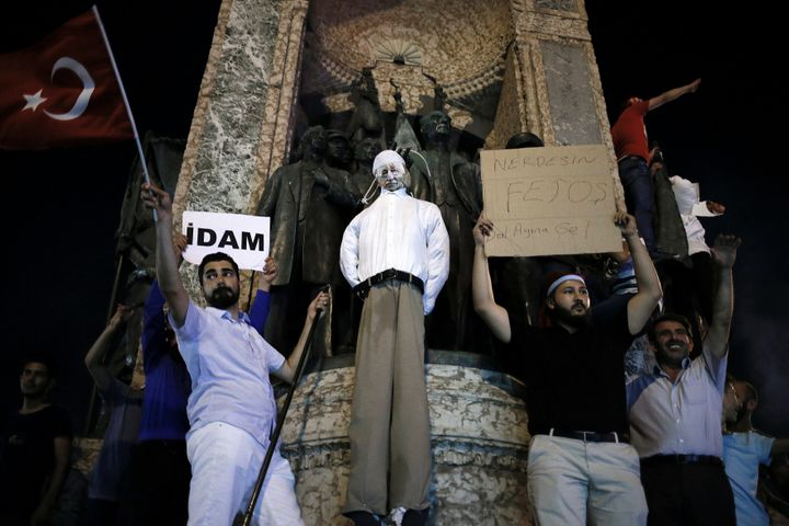 Supporters of the Turkish president hold an effigy of Gulen handing by a noose in Istanbul last week, but author Joshua