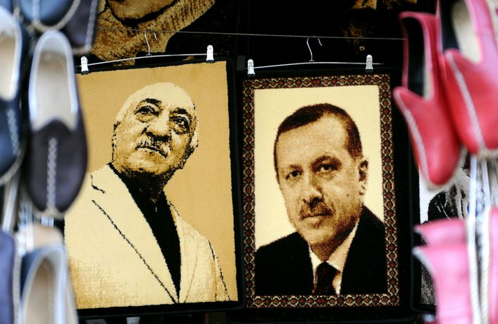 Gulen and Erdogan, pictured above in embroidered images in a Turkish market, were once allies, but are now bitter rivals.