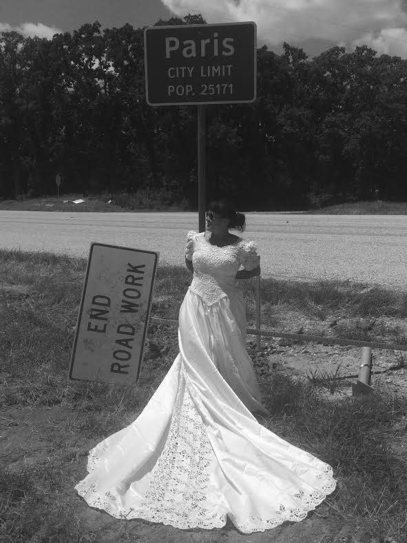 """For her <a href=""""http://www.huffingtonpost.com/entry/texas-woman-poses-in-wedding-gown-after-divorce_us_56e0b06ee4b0b25c9180be26"""">Acid Neutral art project</a>,&nbsp;Herrera donned her wedding dress and had her daughter take photos of her across Texas.&nbsp;"""