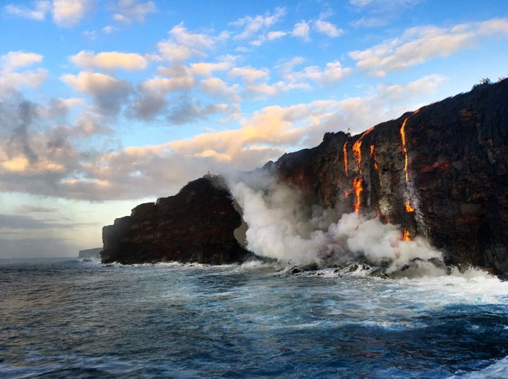 Lava flows into the ocean in Hawaii.
