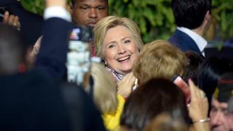 Hillary Clinton, the presumptive Democratic presidential nominee, shakes hands with audience members after addressing the 117th annual VFW National Convention at the Charlotte Convention center on Monday, July 25, 2016 in Charlotte, N.C. (David T. Foster III/Charlotte Observer/TNS via Getty Images)