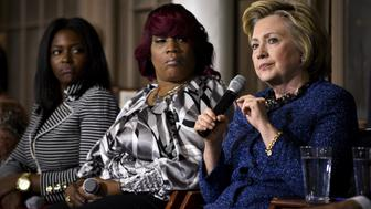 Democratic U.S. presidential candidate Hillary Clinton (R) speaks during an event with former Attorney General Eric Holder and the anti-gun violence group Mothers of the Movement at St. Paul's Baptist Church in Philadelphia, Pennsylvania, U.S., April 20, 2016. Clinton is joined by Nicole Bell, fiance to Sean Bell, (L), and Tanya Brown-Dickerson, mother of Brandon Tate-Brown, both of whom were killed by police.  REUTERS/Charles Mostoller