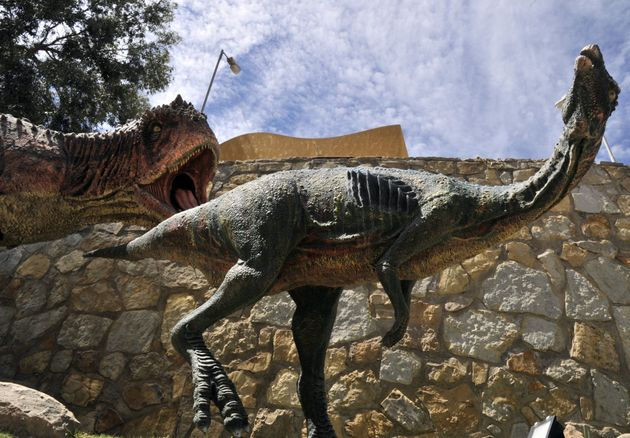 Models of Abelisaurus dinosaurs on display at the Cretaceous Park in Cal Orcko, hill in