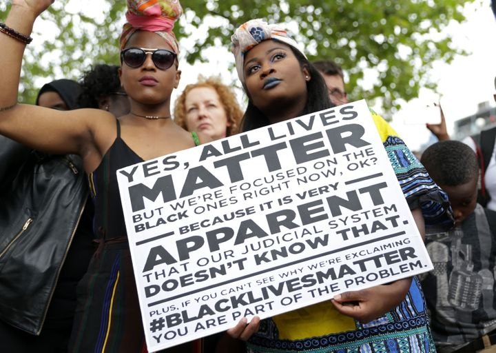 "The ""Black Lives Matter"" and ""All Lives Matter"" debate extends beyond the U.S., too. Earlier this month, two women held"