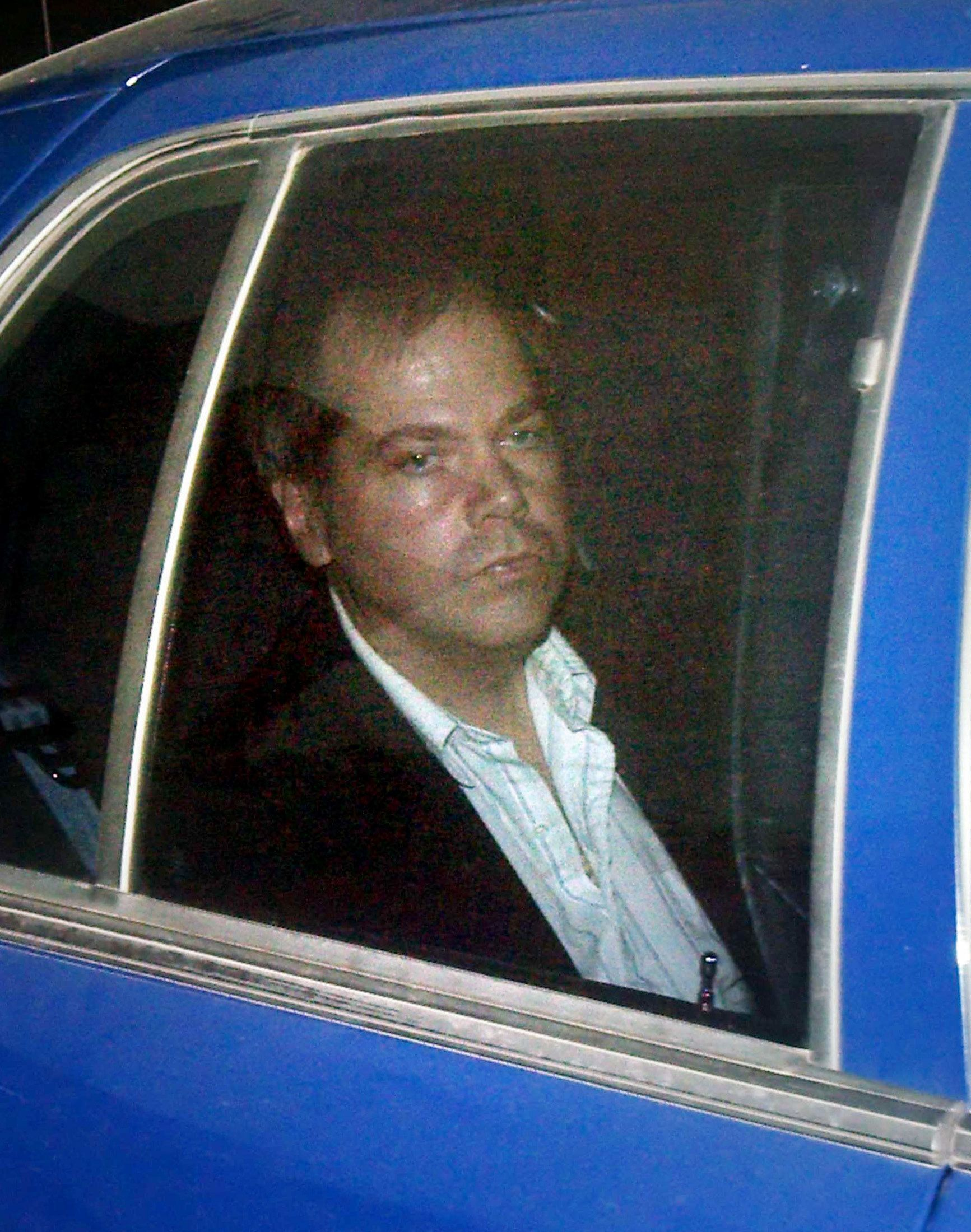 John Hinckley Jr. arrives at the E. Barrett Prettyman U.S. District Court in Washington in this November 19, 2003 file photo.