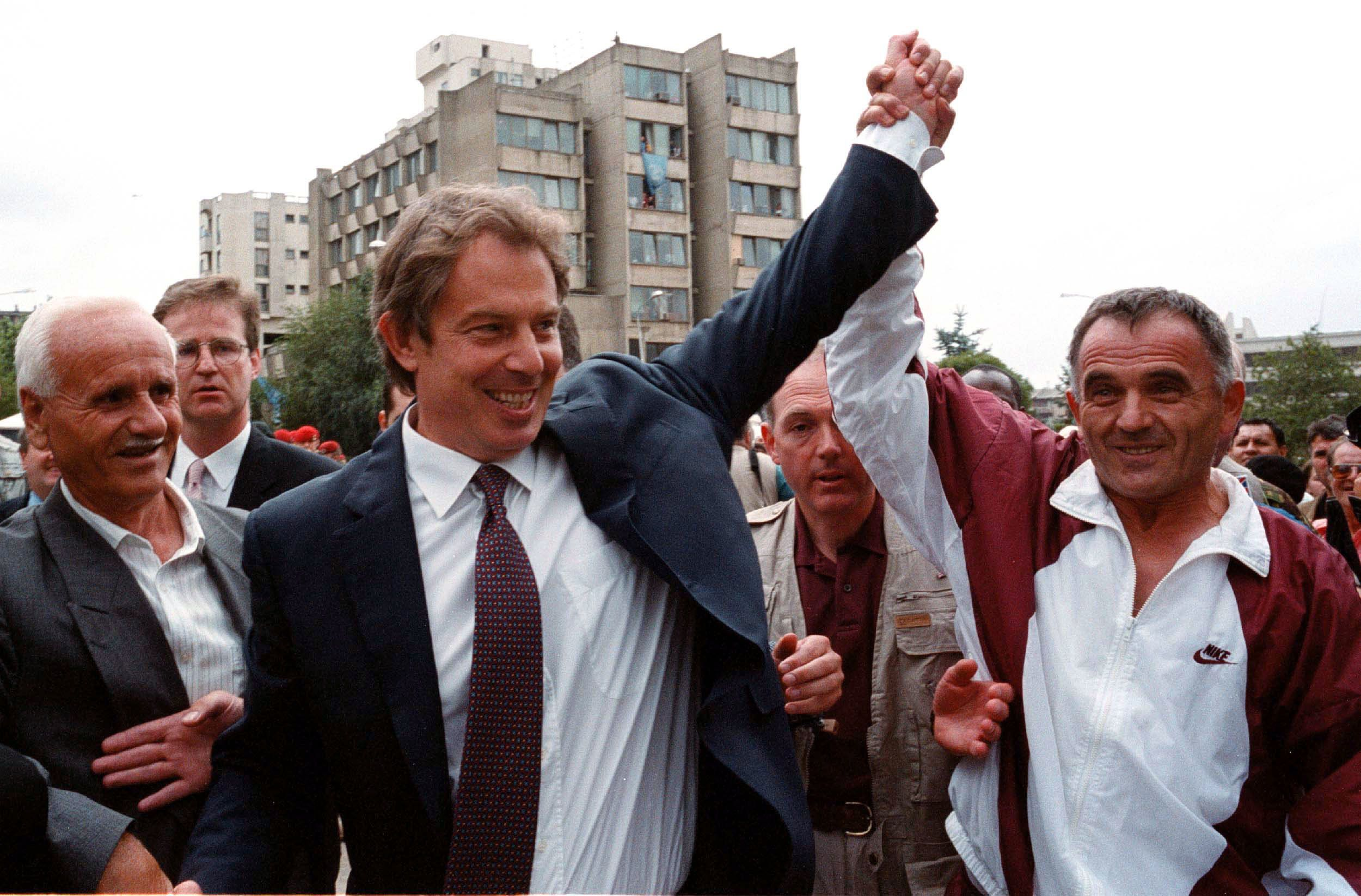 Tony Blair greets an ethnic Albanian in Pristina, Yugoslavia in July