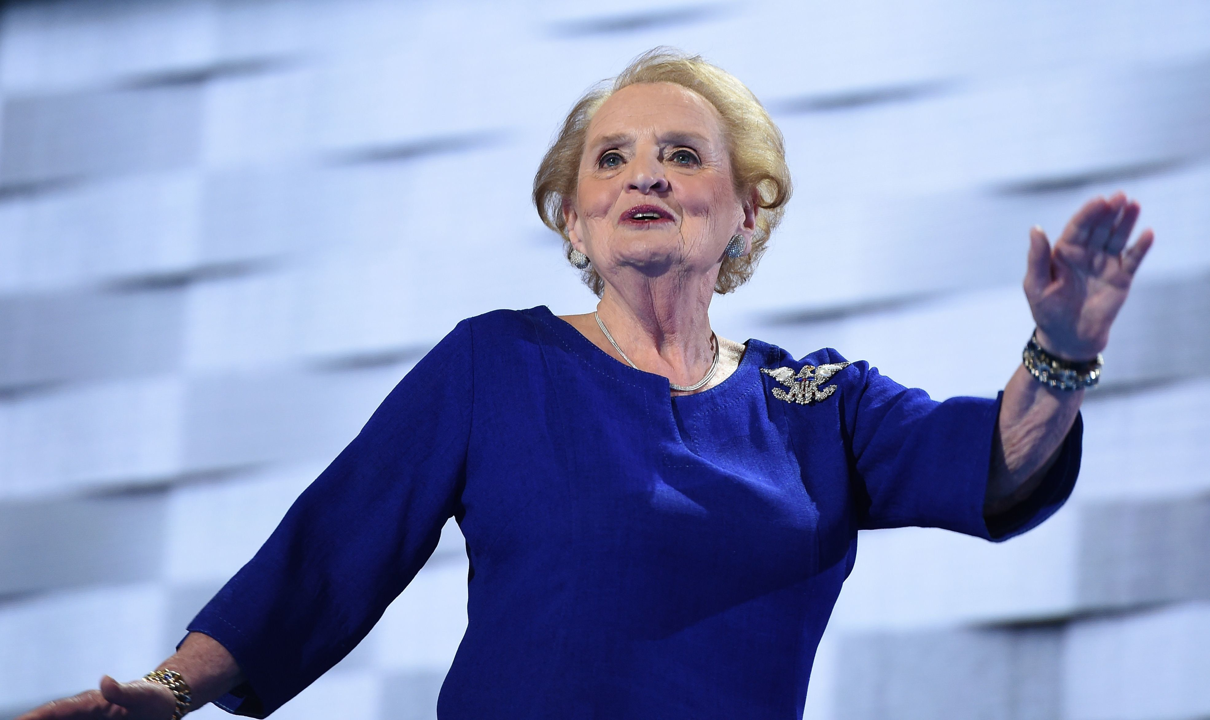 Former US Secretary of State Madeleine Albright waves as she arrives to speak on the second day of the Democratic National Convention at the Wells Fargo Center, July 26, 2016 in Philadelphia, Pennsylvania.      / AFP / Robyn BECK        (Photo credit should read ROBYN BECK/AFP/Getty Images)