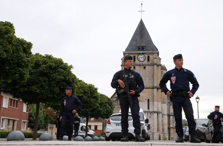 French CRS police stand guard in front of the church a day after a hostage-taking in Saint-Etienne-du-Rouvray near Rouen in N