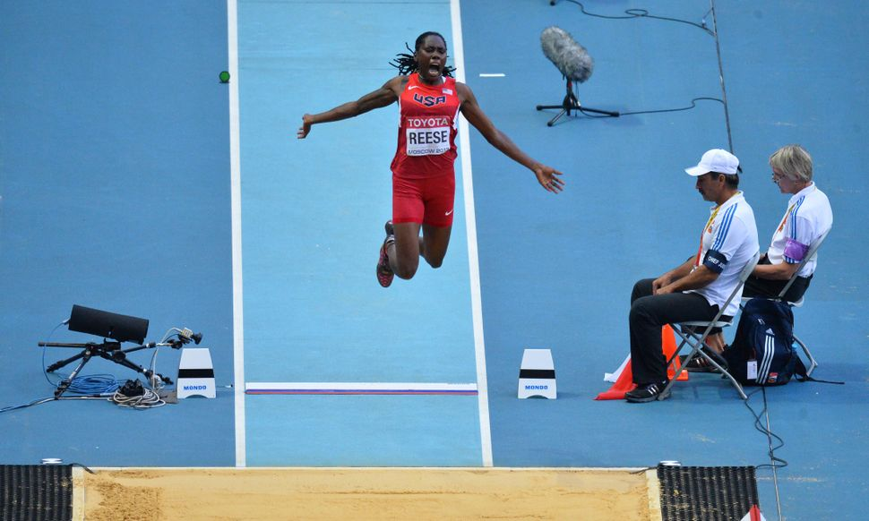US Brittney Reese jumps to victory during the women's long jump final at the 2013 IAAF World Championships at the Luzhniki st