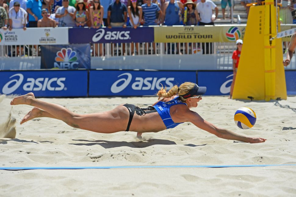 Kerri Walsh Jennings of the United States digs the ball during the FIVB Long Beach Grand Slam on July 26, 2014 in Long Beach,